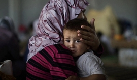 Kazakhstani Women & Children Detained In Syria Return Home