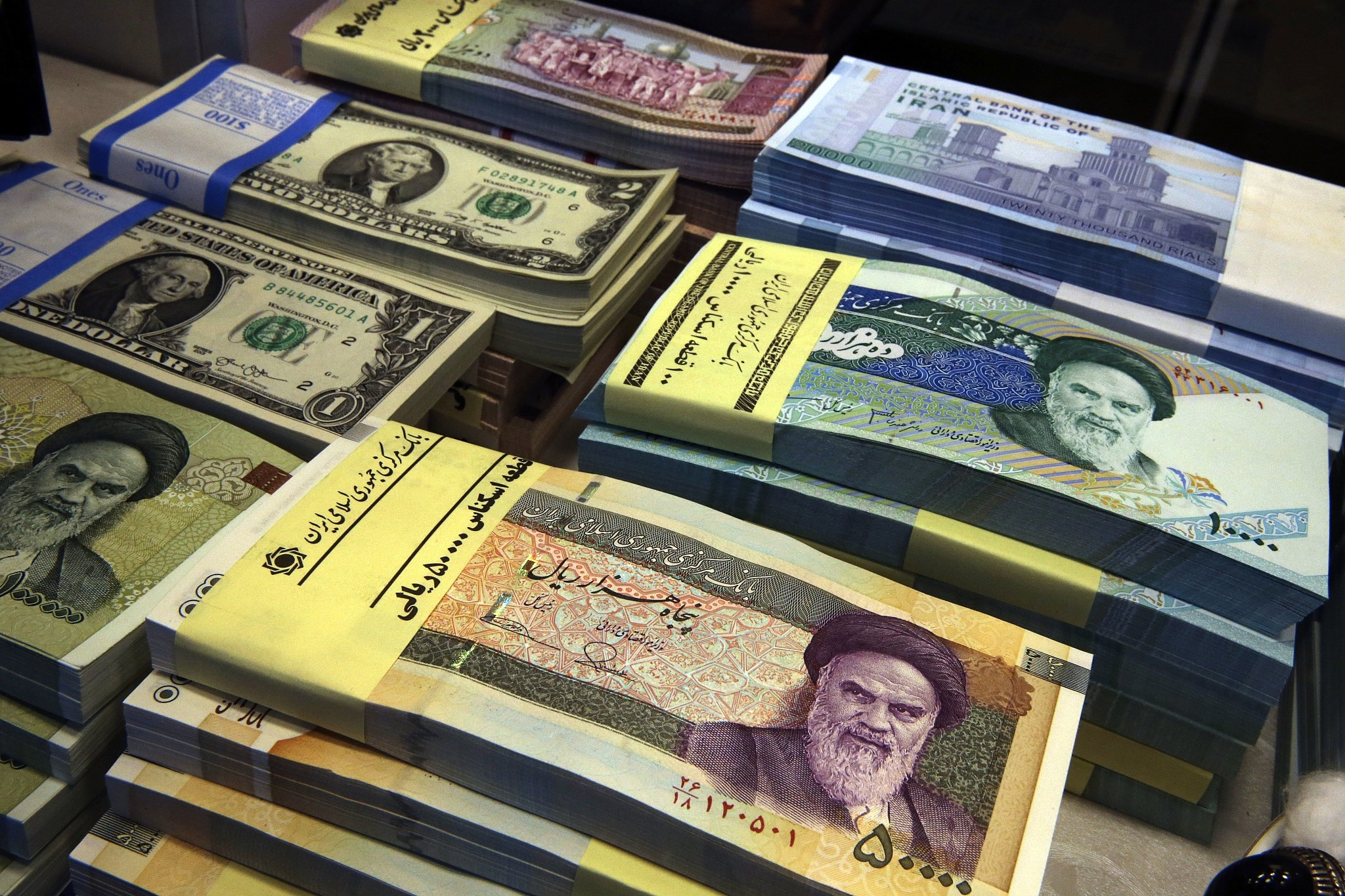 Iranian And Us Banknotes On Display At A Currency Exchange In Downtown Tehran Iran April 4 2017 Vahid Mi Ap